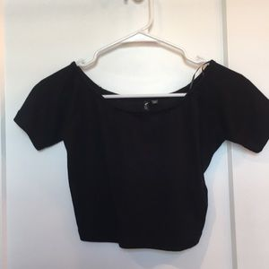 Black crop top semi of shoulders